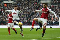 Dele Alli of Tottenham Hotspurand Shkodran Mustafi of Arsenal during Tottenham Hotspur vs Arsenal, Premier League Football at Wembley Stadium on 10th February 2018