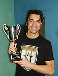 Gilles Marini of Dancing with the Stars (holding winnng trophy) played on the green team which won event at the Celebrity soccer game to benefit Hollywood United for Haiti at 1st Setanta Cup Soccer Festival on April 11, 2009 at Chelsea Pers, NYC. (Photo  by Sue Cofln/Max Photos)