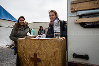 """First Aid Camp - First Team.<br /> <br /> Calais Jungle Camp.<br /> <br /> Under the Sky of Calais & Dunkirk. Two Camps, Two Sides of the Same Coin: Not 'migrants', Not 'refugees', just Humans.<br /> <br /> France, 24-30/03/2016. Documenting (and following) Zekra and her experience in the two French camps at the gate of the United Kingdom: Calais' """"Jungle"""" and Dunkirk's """"Grande-Synthe"""". Zekra lives in London but she is originally from Basra in Iraq. Zekra and her family had to flee Kuwait - where they moved for working reason - due to the """"Gulf War"""", and to the Western Countries' will to """"export Democracy in Iraq"""". Zekra is a self-motivated volunteer and founder of """"Happy Ravers"""", a group of people (not a NGO or a charity) linked to each other because of their love for rave parties but also men and women who meet up every week to help homeless people and other people in need in Central London. (Here there are some of the stories I covered about Zekra and """"Happy Ravers"""": http://bit.ly/1XVj1Cg & http://bit.ly/24kcGQz & http://bit.ly/1TY0dPO). Zekra worked as an English teacher in the adult school at Dunkirk's """"Grande-Synthe"""" camp and as a cultural mediator and Arabic translator for two medic teams in Calais' """"Jungle"""". Please read her story at the beginning of this reportage."""
