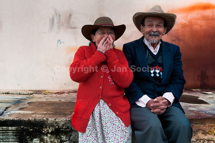 An elderly couple sit on the street of Ciudad Bolívar, Bogota, Colombia, 26 May 2010.