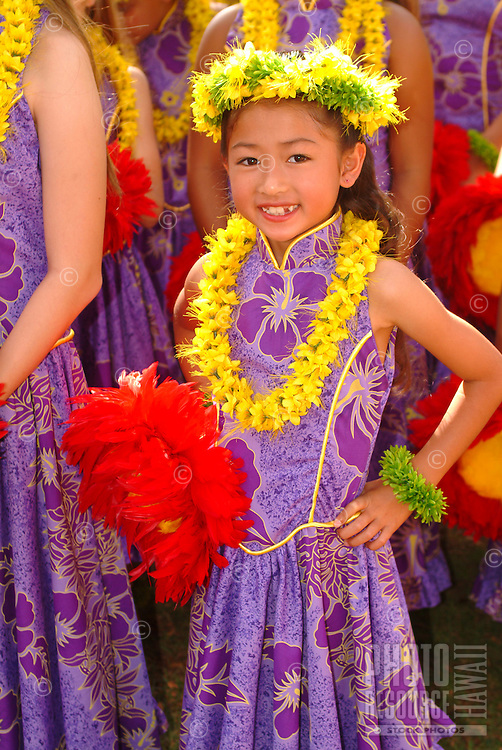 A keiki hula dancer from Halau Hula O Hokulani dancing in the Lei Day program at the Kapiolani Park bandstand in Waikiki in Honolulu, Hawaii