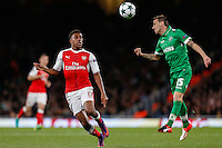 Alex Iwobi of Arsenal looks on as Yordan Minev of Ludogorets Razgrad clears the ball during the UEFA Champions League match between Arsenal and PFC Ludogorets Razgrad at the Emirates Stadium, London, England on 19 October 2016. Photo by David Horn / PRiME Media Images.