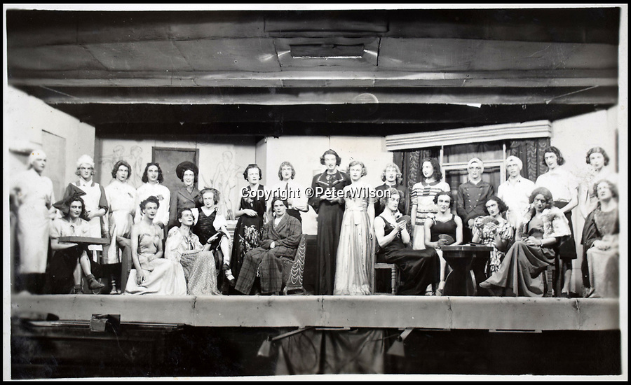 BNPS.co.uk (01202 558833)<br /> Pic: PeterWilson/BNPS<br /> <br /> A stage show with prisoners dressed in drag.<br /> <br /> A fascinating photo album has to come to light to reveal what went on inside a German POW camp - including stage shows in drag.<br /> <br /> The Stalag Luft IV B album was compiled by British prisoner David Courtney, of 102 Squadron, whose Halifax was shot down near Berlin on January 20, 1944.<br /> <br /> One of the photos shows the funeral of a British soldier who was assassinated by the German guards, although they have taken part in the ceremony by lifting their guns above the coffin.<br /> <br /> Another shows a theatre performance put on by inmates where the performers were dressed as women to keep up morale.