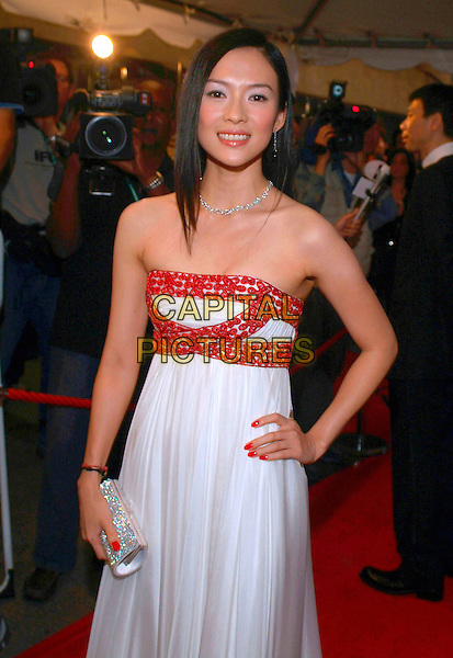 "ZIYI ZHANG.""The Banquet"" Premiere during the 2006 Toronto International Film Festival held at Roy Thomson Hall, Toronto, Ontario, Canada, .15 September 2006..half length strapless red beaded white dress clutch bag purse hand on hip.Ref: ADM/BP.www.capitalpictures.com.sales@capitalpictures.com.©Brent Perniac/AdMedia/Capital Pictures."
