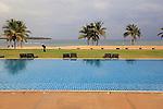 Gardener and pool Amaya Beach Resort and Spa hotel, Pasikudah Bay, Eastern Province, Sri Lanka, Asia