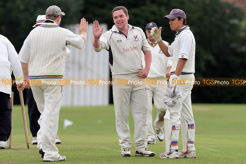 Upminster bowler Alan Ison claims his second wicket - Gidea Park & Romford CC (batting) vs Upminster CC - Essex Cricket League Dukes Twenty20 Competition - 18/06/11 - MANDATORY CREDIT: Gavin Ellis/TGSPHOTO - Self billing applies where appropriate - Tel: 0845 094 6026
