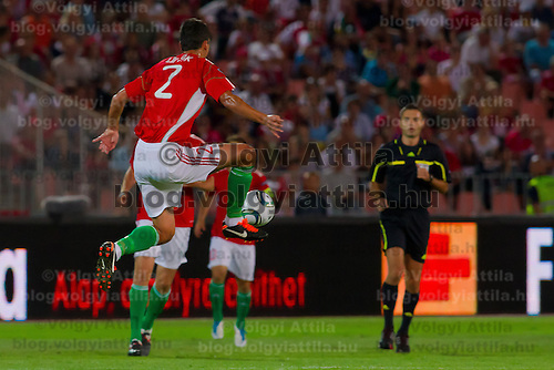 Hungary's Zoltan Liptak (C) jumps to kick the ball durint the UEFA EURO 2012 Group E qualifier Hungary playing against Sweden in Budapest, Hungary on September 02, 2011. ATTILA VOLGYI
