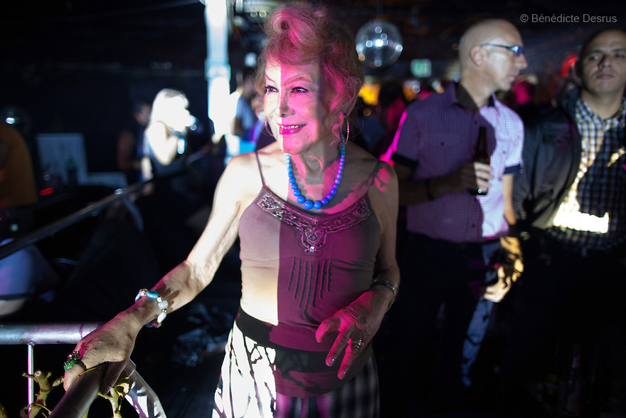 """September 2, 2012 - Mexico City, Mexico - Samantha dances at a nightclub inMexico City. Samantha Flores is an 80-year-old transgender woman from Veracruz, Mexico. She is a prominent social activist for LGBTQI rights and is the founder of the non-profit organization """"Laetus Vitae"""", a day shelter for elderly gay people in Mexico City. Senior citizens in general are many times prone to neglect and abandonment by their families, leaving them all but invisible. Their plight can be even worse if they are homosexual. Photo credit: Bénédicte Desrus"""