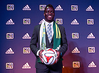 #17 overall pick Schillo Tschuma of the Portland Timbers stands on the podium during the MLS SuperDraft at the Pennsylvania Convention Center in Philadelphia, PA, on January 16, 2014.