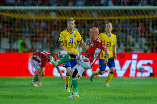 Sweden's Christian Wilhelmsson (L back) and Oscar Wendt (R back) watch as Hungary's Jozsef Varga (C front) takes the ball during the UEFA EURO 2012 Group E qualifier Hungary playing against Sweden in Budapest, Hungary on September 02, 2011. ATTILA VOLGYI