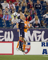 New England Revolution forward Ilica Stojica (9) and Houston Dynamo defender Bobby Boswell (32) battle for head ball. The New England Revolution defeated Houston Dynamo, 1-0, at Gillette Stadium on August 14, 2010.