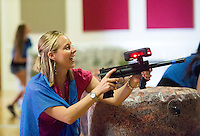 NWA Democrat-Gazette/JASON IVESTER <br /> University of Arkansas masters student Danielle Brecht (cq) takes aim on Thursday, Sept. 24, 2015, while playing laser tag inside the Arkansas Union on the Fayetteville campus. The free event for students was hosted by University Programs Daytime Committe.