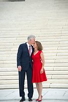 Associate Justice of the Supreme Court of the United States Neil M. Gorsuch, left, and his wife, Marie Louise, right, pose for photos on the front steps of the US Supreme Court Building after the investiture ceremony for Justice Gorsuch in Washington, DC on Thursday, June 15, 2017. <br /> Credit: Ron Sachs / CNP /MediaPunch