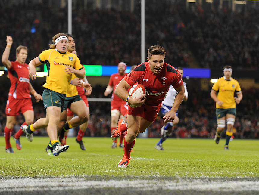 Wales Rhys Webb scores his sides first try <br /> <br /> Photo by Ian Cook/CameraSport<br /> <br /> International Rugby Union - Dove Men Series - Wales v Australia - Saturday 8th November 2014 - Millennium Stadium - Cardiff<br /> <br /> &copy; CameraSport - 43 Linden Ave. Countesthorpe. Leicester. England. LE8 5PG - Tel: +44 (0) 116 277 4147 - admin@camerasport.com - www.camerasport.com