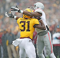 Minnesota Golden Gophers defensive back Eric Murray (31) clearly interferes with Ohio State Buckeyes wide receiver Michael Thomas (3) before the ball arrives late in the second quarter at TCF Bank Stadium on November 15, 2014. (Chris Russell/Dispatch Photo)