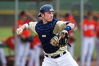 Notre Dame Fighting Irish catcher Joe Hudson #4 during warmups before a game against the Illinois Fighting Illini at the Big Ten/Big East Challenge at Walter Fuller Complex on February 17, 2012 in St. Petersburg, Florida.  (Mike Janes/Four Seam Images)