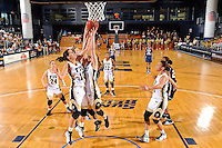 21 January 2012:  FIU guard Fanni Hutlassa (10), guard Zsofia Labady (3) and guard Sasha Melnikova (5) jump for a rebound in the first half as the Florida Atlantic University Owls defeated the FIU Golden Panthers, 50-49, at the U.S. Century Bank Arena in Miami, Florida.