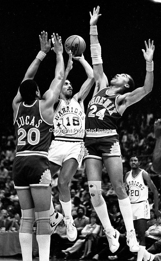 Golden State Warrior Lorenzo Romar against the Phoenix Suns Dennis Johnson and Lucas..(1982 photo/Ron Riesterer)