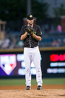 Charlotte Knights starting pitcher Chris Volstad (44) looks to his catcher for the sign against the Columbus Clippers at BB&T BallPark on May 3, 2016 in Charlotte, North Carolina.  The Clippers defeated the Knights 8-3.  (Brian Westerholt/Four Seam Images)
