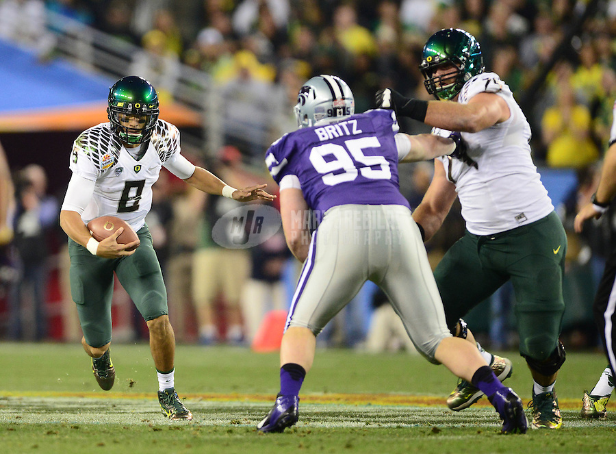 Jan. 3, 2013; Glendale, AZ, USA: Oregon Ducks quarterback Marcus Mariota (8) against the Kansas State Wildcats during the 2013 Fiesta Bowl at University of Phoenix Stadium. Oregon defeated Kansas State 35-17. Mandatory Credit: Mark J. Rebilas-