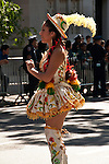A couple dressed in traditional clothes and dancing during the Hispanic Parade in New York City, representing Bolivia