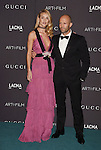 LOS ANGELES, CA - NOVEMBER 07: Model Rosie Huntington-Whiteley, wearing Gucci, (L) and actor Jason Statham attend LACMA 2015 Art+Film Gala Honoring James Turrell and Alejandro G Iñárritu, Presented by Gucci at LACMA on November 7, 2015 in Los Angeles, California.