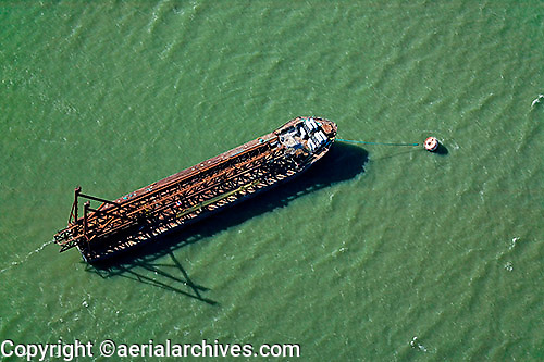 aerial photograph of anchored construction barge loaded for San Francisco Oakland Bay Bridge project