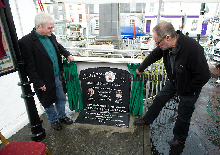 Musicians Charlie Pigott and Sean Tyrell unveil a commemorative stone in memory of Joe Cooley and Kieran Collins, by  in Gort. Photograph by John Kelly.