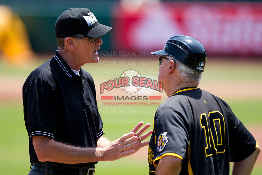 Head Coach Gene Stephenson (10) of the Wichita State Shockers argues with Third Base Umpire Mike Droll during a game against the Missouri State Bears in the 2012 Missouri Valley Conference Championship Tournament at Hammons Field on May 23, 2012 in Springfield, Missouri. (David Welker/Four Seam Images)