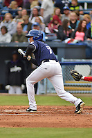 Asheville Tourists second baseman Alec Mehrten #7 squares to bunt during a game against the  Greenville Drive at McCormick Field on May 17, 2014 in Asheville, North Carolina. The Tourists defeated the Drive 14-6. (Tony Farlow/Four Seam Images)