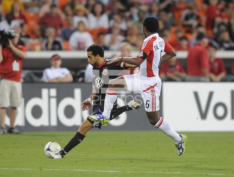 D.C. United forward Dwayne de Rosario (7) makes a pass against Toronto FC midfielder Julian de Guzman (6). D.C. United defeated Toronto FC 3-1 at RFK Stadium, Saturday May 19, 2012.