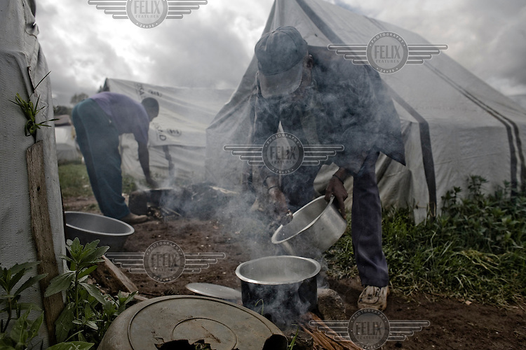 IDPs (Internally Displaced Persons) prepare a simple meal in a camp in Eldoret. A year after a political crisis led to violence, tens of thousands of those displaced still live in the IDP camps in the Rift Valley.