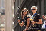 10 July 2015: Carli Lloyd (left) and Megan Rapinoe (right, holding the WWC Championship Trophy). The United States Women's National Team was honored with a parade down New York City's Canyon of Heroes for winning the FIFA 2015 Women's World Cup in Canada.