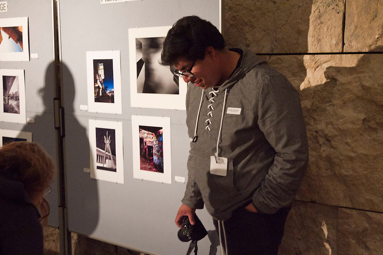 Pierce College student Jorge Alvarado posing with his work while  participating in a Student  Photography Installation during the Getty Museum's College Night in Los Angeles April 15, 2013..The students have been participating in an architectural photo class in conjunction with the Getty's Pacific Standard Time  Presents: Modern Architecture in L.A. along with three other Los Angeles area community colleges.. Photo: Gerard Burkhart...Gerard Burkhart Photo