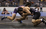 Rito Hernandez, of Spanish Springs, and Spencer Rich, of Rocky Mountain, compete at the Sierra Nevada Classic wrestling tournament in Reno, Nev., on Friday, Dec. 28, 2012. .Photo by Cathleen Allison
