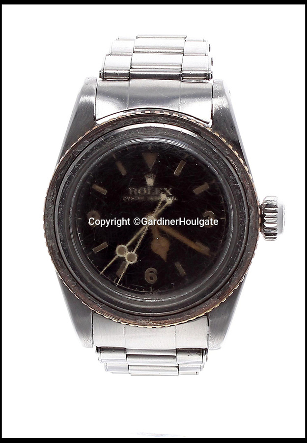 BNPS.co.uk (01202 558833)<br /> Pic:  GardinerHoulgate/BNPS<br /> <br /> A rare Rolex watch has emerged for sale for £150,000 - despite being damaged.<br /> <br /> The 1958 Rolex Oyster Perpetual 'Big Crown' Submariner has badly scratched glass, surface marks on its hands and a loose bezel.<br /> <br /> It is so valuable because it still has its original 3-6-9 Explorer dial which was produced in very small number during the late 1950s and early '60s. <br /> <br /> The majority of dials would have been replaced when they were serviced in the intervening six decades, so finding a timepiece with an original dial is the holy grail for collectors.