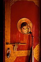 Annapurna Circuit Trek, Buddhist Temple in Marpha.  This shot was taken very early in the morning, as the monks opened the temple door for morning payers.  I love the contrast of tradition, with the newess of the lock in the door.