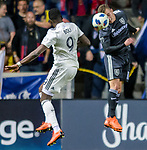 Real Salt Lake forward Brooks Lennon (12) heads the ball away from Colorado Rapids forward Yannick Boli (9) in the second half Saturday, April 21, 2018, during the Major League Soccer game at Rio Tiinto Stadium in Sandy, Utah. RSL beat the Colorado Rapids 3-0. (© 2018 Douglas C. Pizac)