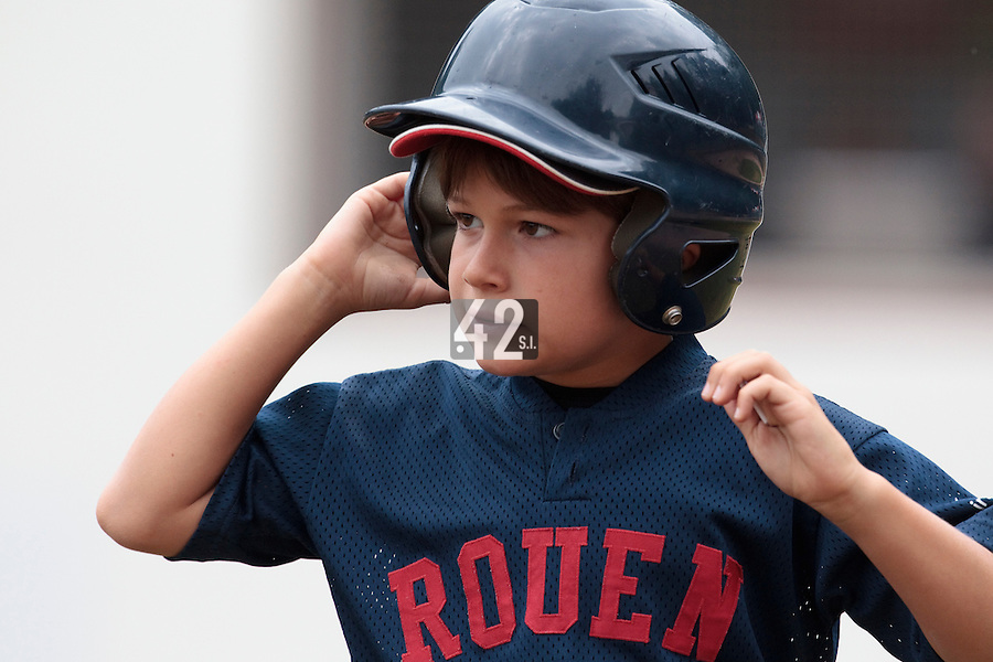 14 July 2010: Auguste, the bat boy, is seen during day 2 of the Open de Rouen, an international tournament with Team France, Team Saint Martin, Team All Star Elite, at Stade Pierre Rolland, in Rouen, France.