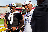 TALLAHASSEE, FLA. 4/14/18-Former Florida State football player Deion Sanders, left, joins Head Coach Willie Taggart prior to the start of the spring game action Saturday at Doak Campbell Stadium in Tallahassee. <br /> <br /> COLIN HACKLEY PHOTO