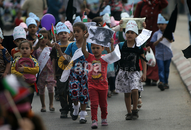"Palestinian children participate in a rally marking the Nakba or the ""Day of Catastrophe"" commemorations in Khan Younis in the southern Gaza Strip, on May 07, 2014. Palestinians commemorate the ""Nakba,"" when hundreds of thousands fled or were expelled from their homes in the war that accompanied Israel's declaration of independence in 1948. Photo by Eyad Al Baba"