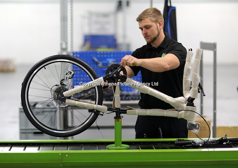 Pictured: Jack Appleby on the assembly line Monday 15 August 2016<br /> Re: Frog Bikes in Mamhilad Estate Park in Pontypool, Wales, UK