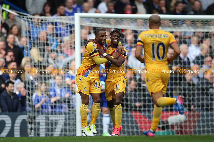 Wilfried Zaha of Crystal Palace and Jason Puncheon of Crystal Palace celebrate their second goal scored by Christian Benteke of Crystal Palace during Chelsea vs Crystal Palace, Premier League Football at Stamford Bridge on 1st April 2017