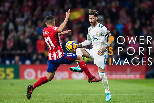 Sergio Ramos of Real Madrid vies for the ball with Angel Correa of Atletico de Madrid during the La Liga 2017-18 match between Atletico de Madrid and Real Madrid at Wanda Metropolitano  on November 18 2017 in Madrid, Spain. Photo by Diego Gonzalez / Power Sport Images