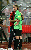 The United States' Brian Perk, (13) is comforted by a coach after losing the match to South Korea after the FIFA Under 20 World Cup Group C match between the United States and South Korea at the Mubarak Stadium on October 02, 2009 in Suez, Egypt. The US team lost 3-0.