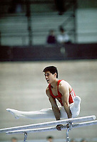 Li Ning of China performs on parallel bars at 1985 World Championships in men's artistic gymnastics at Montreal, Canada in mid-November, 1985.  Photo by Tom Theobald.