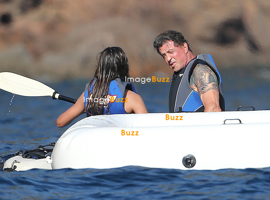 """EXCLUSIVE - SYLVESTER STALLONE & FAMILY IN CORSICA - August 5th-6th, Sylvester Stallone, his three daughters Sophia, Sistine, Scarlet and wife Jennifer Flavin are still enjoying their vacation in France. After the French Riviera, Stallone & family arrived in Corsica aboard their super yacht called """" Te Manu """" , one of the most impressive charter yachts in the world with 6 staterooms beautifully decorated in soothing neutrals that can accommodate up to 12 guests. Another exceptional feature of this yacht is the elevator that connects all of her four decks. The rental price is 199.000 Euros/week."""