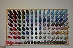 Thread Peg-board with a rainbow of  on a workshop wall.