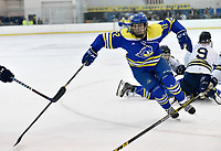 Delaware's Colin Emerich (12) changes direction. Emerich had 1 goal and 3 assists as Delaware defeated Navy 8-3 at McMullen Hockey Arena.<br /> <br /> Photo by Randy Litzinger