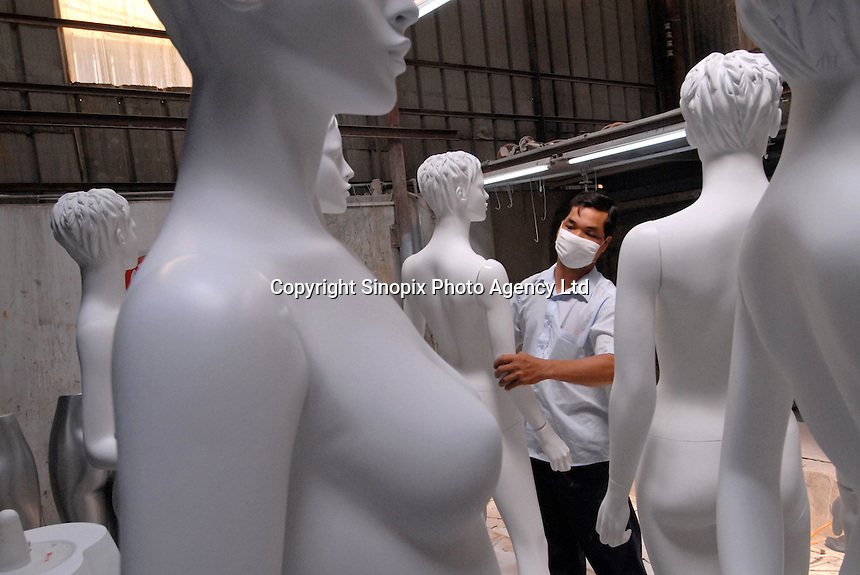 Guan Feng Mannequin Factory in Zhongshan, China. The process of mannequin manufacturing involves the use of toxic cancer causing resin and the use of fibre glass that creates a poisonous dust. The workers are paid higher wages to work in such conditions..13 Jun 2007